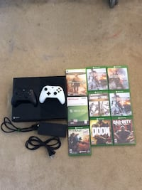 Xbox 360 with two controllers and 8 games Fredericksburg, 22406