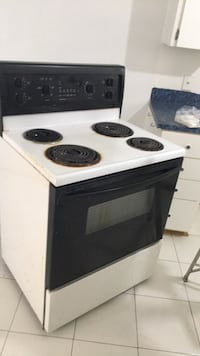 white and black electric coil range oven Montréal, H1S 3B3