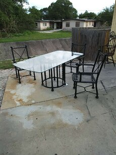 rectangular glass top table with chairs