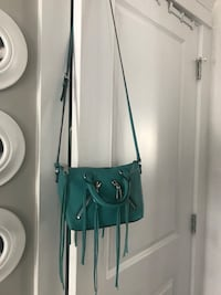 New with tags ~ authentic rebecca minkoff teal leather cross body bag  tags attached, comes with dust bag & extra strap   would make an amazing christmas gift