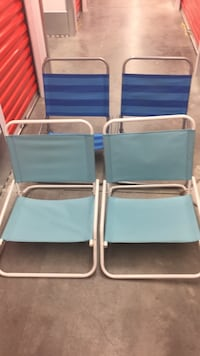 two blue and white folding chairs Greenville, 28590