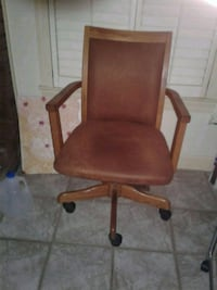brown leather padded rolling armchair Clarksville, 37042