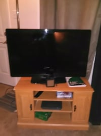 black flat screen TV with remote Edmonton, T6A 2C1