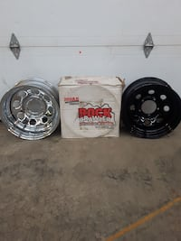 two chrome and black bullet-hole vehicle wheels