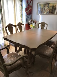 Dining room table Ashley's with 2 captain chairs and 4 chairs and 2 extensions Ottawa, K1G 5L4