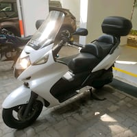white and black motor scooter Singapore