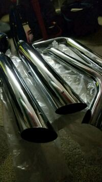two chrome motorcycle mufflers