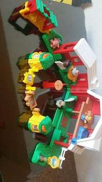 green, red ,and yellow barn toy set