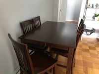Rectangular brown wooden table with six chairs dining set Falls Church, 22041