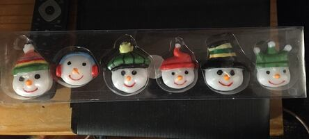 Set of snowman floating candles