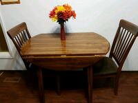 Dinning table with folding leafs  3125 km