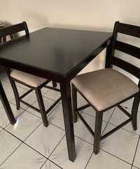 Counter high table and 2 chairs