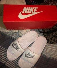 pair of white Nike slide sandals on box San Francisco, 94108