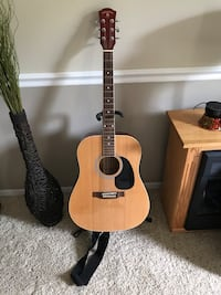 Like New Indiana Acoustic Guitar with Gig Bag, Stand, Strap, Capo, & Chord Book Medina, 44256