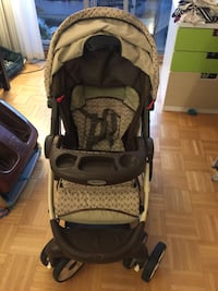 Baby's black and gray graco stroller