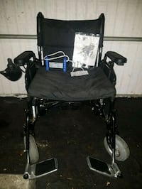 black and gray folding wheelchair 2279 mi