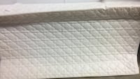 Quilted white baby mattress for changing
