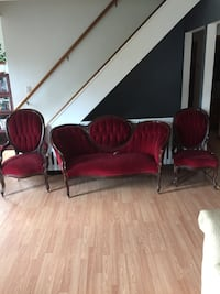 two red fabric padded armchairs null