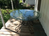 Round clear glass top table with black metal base Lacy-Lakeview, 76705