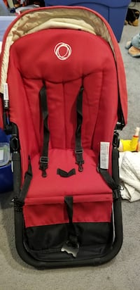 red and black stroller Milton