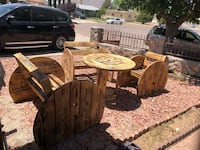 round brown wooden table with four chairs El Paso, 79904
