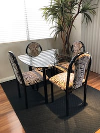 "Dining set, glass table 48"" & 4 Zebra chairs black & white"