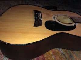 Small first act acoustic  guitar