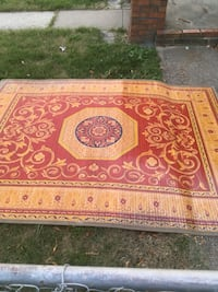 Red and brown floral area rug Baltimore, 21220
