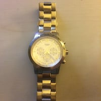 silver and white round guess chronograph watch with linked strap