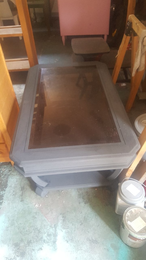 rectangular gray wooden framed clear glass top coffee table