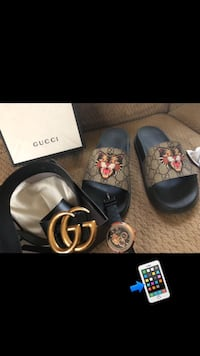 pair of black Gucci slide sandals Alexandria, 22314