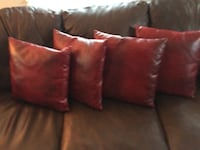 4 red leather pillows