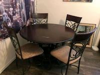 round black wooden table with four chairs dining s Las Vegas, 89123