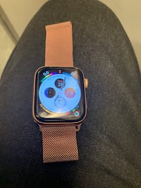 Gold Apple Watch 44mm series 4 with applecare warranty