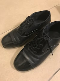 pair of black leather dress shoes Toronto, M8Z 3A3