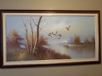five birds flying beside bare trees under calm body of water painting