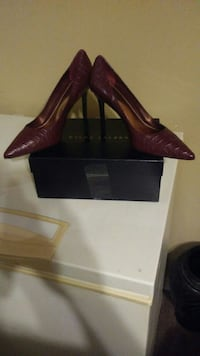 pair of brown leather pointed toe platform heeled