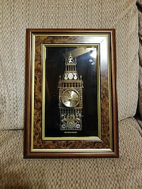 brown tower clock artwork with brown wooden frame
