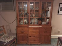 brown wooden framed glass display cabinet HICKSVILLE