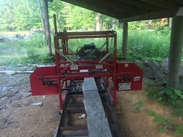16 HP v twin slightly used saw mill in mint condition