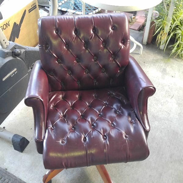 Office chair, bonded leather (?), VERY sturdy, on wheels