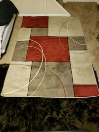 brown, red, and white area rug Powell, 43065