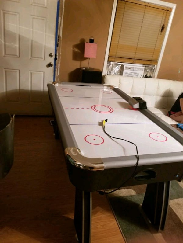 Air hockey table c5d438e2-d566-444f-ae15-cf9db0b28663