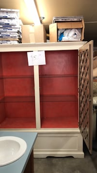 "Armoire.  77"" tall. 64"". Long.  23"" deep"