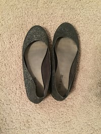 pair of black flat shoes Lincoln, 68504