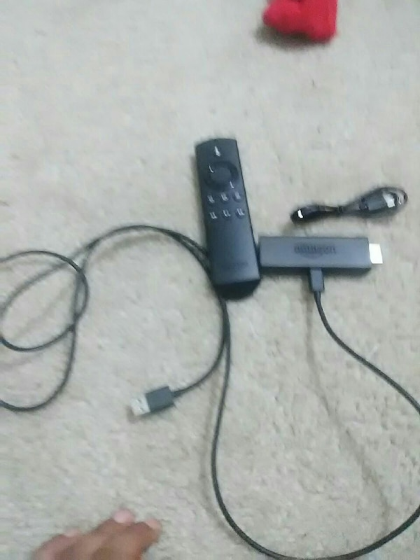 black Amazon TV stick with remote