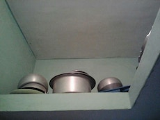 stainless steel and black cookware set