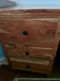 Three drawer light wood nightstand