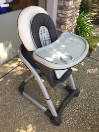 Baby's grey and black feeding highchair