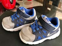 pair of gray-and-blue Nike running shoes 1617 mi